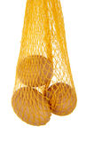 Yellow net with three eggs Stock Photos
