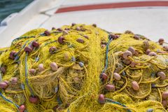 Yellow nets on a boat deck. Pile of yellow nets on a fisherman boat deck in Zante Island, Greece stock images