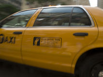 Yellow New York taxicab. Close up of side of yellow New York taxicab cab in motion, New York, U.S.A royalty free stock photos