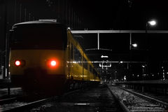 Yellow nighttrain.. A yellow nighttrain in a black and white trainstation royalty free stock images