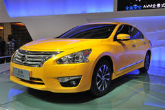 Yellow Nissan Teana. Road to Chinas West - 16th Chengdu Motor Show, August 31th-September 8th, 2013 Stock Photos