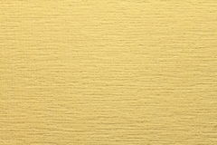 Yellow non-woven wallpaper for painting. Yellow background abstract design texture. Stock Images