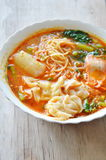 Yellow noodle with pork dumpling in spicy soup on bowl Royalty Free Stock Images