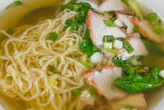 Yellow noodle soup with red pork Stock Image