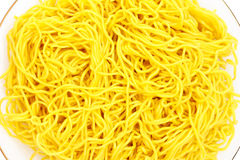 Yellow noodles. Closeup of the yellow noodles on plate Stock Images