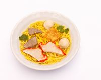 Yellow noodles soup. Yellow noodles soup with pork,won ton and meatballs on bowl Stock Image