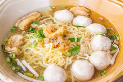 Yellow noodles with soup in Thailand. Thai style yellow noodles with pork and soup Royalty Free Stock Photo