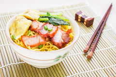Yellow noodles and wonton with roasted pork Stock Photo