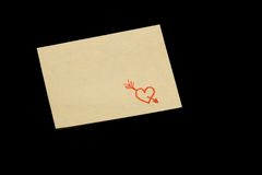 Yellow note. With a red heart Royalty Free Stock Image