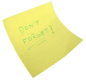 Yellow note. Post-it with 'don't forget' words on a white background Stock Photo