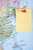 Yellow Note And Red Pin On Map Stock Photo