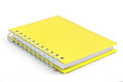 Yellow note book. Isolated yellow note book on white background Royalty Free Stock Photos