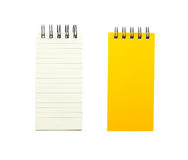 Yellow note book and blank paper Royalty Free Stock Photos