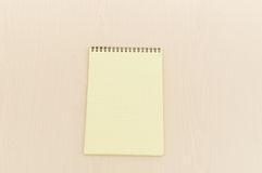 Yellow note book with lots Royalty Free Stock Photography