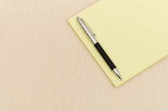 Yellow note book with lots Royalty Free Stock Image