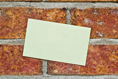 Yellow Note On brick wall Royalty Free Stock Photo
