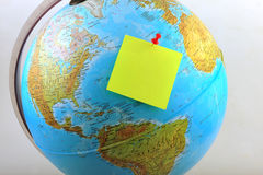 Yellow note on Earth Stock Image