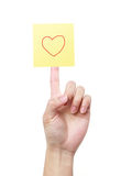 Yellow note with heart on finger Royalty Free Stock Photo