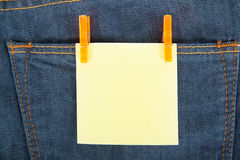 Yellow note on jeans Stock Photos