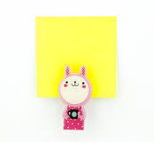 Yellow note pad with pink rabbit clip Stock Photos