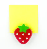 Yellow note pad with strawberry clip Royalty Free Stock Photos
