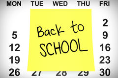 Yellow Note Paper with Back to School Sign over Calendar. 3d Ren Stock Photo