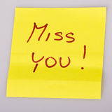 Yellow note paper miss you message Stock Photo