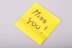 Yellow note paper miss you message Royalty Free Stock Photography