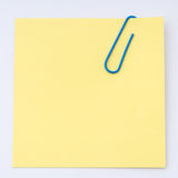 Yellow Note Paper With Paper Clip Royalty Free Stock Photography