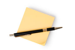 Yellow note paper and pen Royalty Free Stock Photography