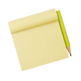 Yellow note paper and pencil Stock Images