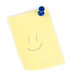 Yellow note paper with push and smile Royalty Free Stock Photography
