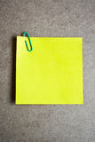 Yellow note paper on wooden background. Royalty Free Stock Images