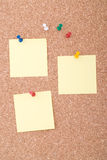 Yellow Note Papers With Tacks On Cork Surface Royalty Free Stock Photo