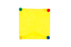Yellow note with pins on white background Stock Photo