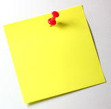 Yellow note with red pin Stock Photography
