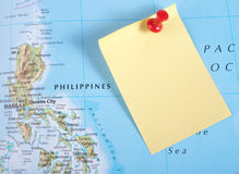 Yellow Note and red pin on map Royalty Free Stock Image