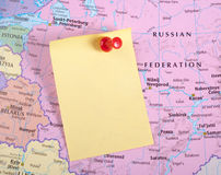 Yellow Note and red pin on map Stock Images