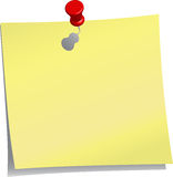 Yellow note and red push pin Stock Images