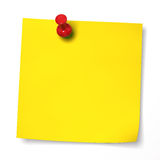 Yellow note with red thumbtack stock photo