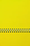 A yellow notebook. Royalty Free Stock Image