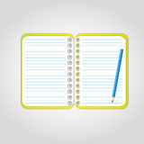 Yellow notebook. Pencil on blank page with yellow cover Stock Photography