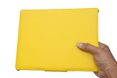 Yellow notebook and hand Stock Photos