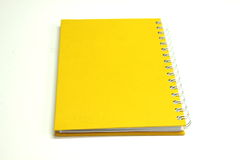 Yellow notebook paper Royalty Free Stock Images