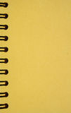 Yellow notebook with spirals. Yellow notebook close-up with wlack spirals royalty free stock photo