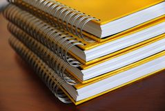 Yellow notebooks stack Stock Photo