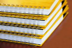 Yellow notebooks stack Stock Images