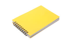 Yellow notepad. Spiral ring-bound yellow notepad, on a white background Royalty Free Stock Photos