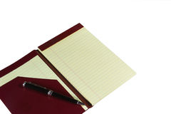 Yellow Notepad. Blank page of a yellow notepad with inkpen Stock Photography