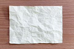 Yellow notepad paper crumpled of empty and copy space on wooden. Background,You can input the message text in picture stock photography